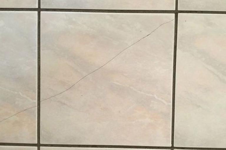 How do I restore a damaged tile?