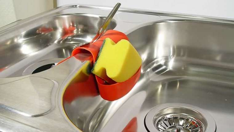 How do I take away rust from the stainless-steel sink?